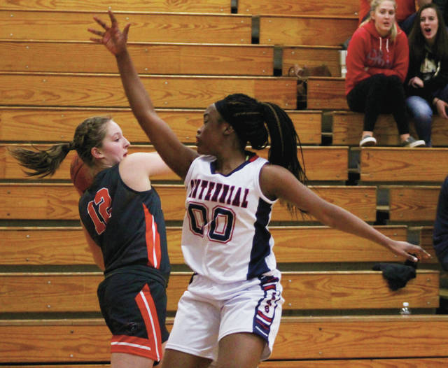 Delaware Hayes freshman Chloe Jeffers (12) looks to pass while being defended by Centennial's Naa Dromo Korley (00) in the Pacers' 70-41 win over the host Stars Saturday night in Columbus.