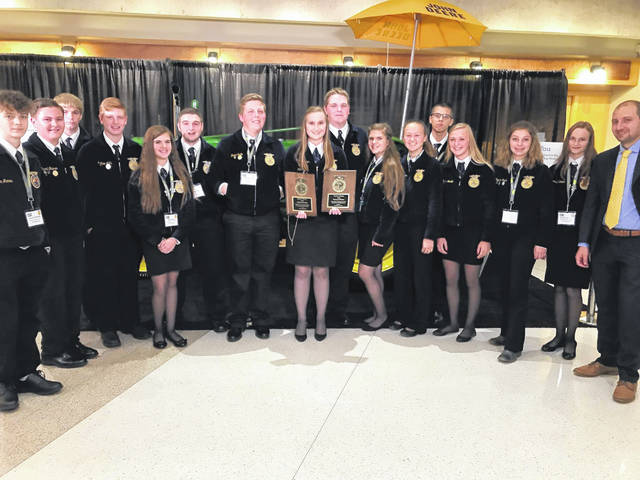 Buckeye Valley graduate Sarah Lehner, center, poses with other Buckeye Valley and Delaware Area Career Center FFA members at the convention last week in Indianapolis.