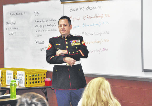 Purple Heart recipient Greg Hughes talks to a class about his time in the Marines during Monday's veterans celebration at Liberty Middle School.