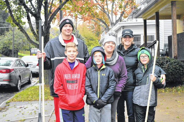 Volunteering is a family affair for the Robe family, who spent the day raking leaves at the homes of older adults in Delaware County.
