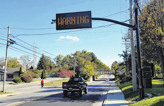 """Vehicles too tall to make it under the """"Can Opener"""" on West Central Avenue will trip a nearby sensor that will cause the message board to display warnings like the one above."""