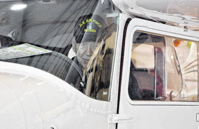 Once seated in the plane, Allen looked out to all his friends as they cheered him on before his flight Wednesday morning at the Delaware Municipal Airport.