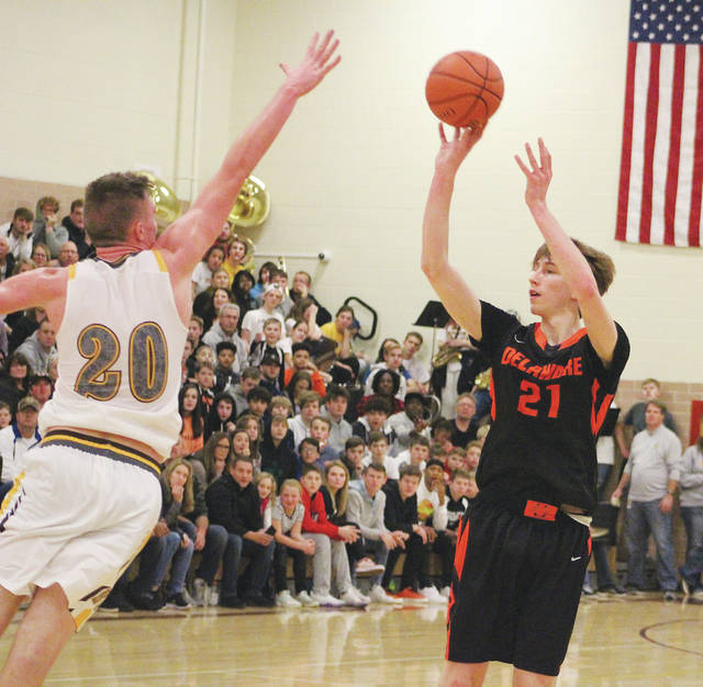 Delaware Hayes' Paul Burris shoots (21) over Buckeye Valley's Troy Scowden during the first half of Friday's season opener at BV.