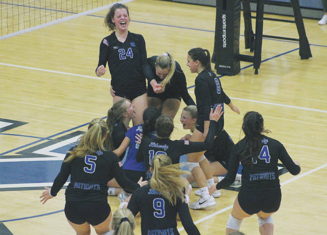 Olentangy Liberty players celebrate after knocking off Dublin Coffman in five sets in a Division I regional semifinal Thursday at Worthington Kilbourne.