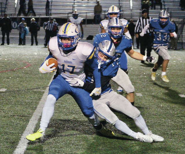 Olentangy Liberty's Grant Wilson takes down Gahanna's C.J. Kiss (17) during the first half of last Friday's Division I, Region 2 opener in Powell.