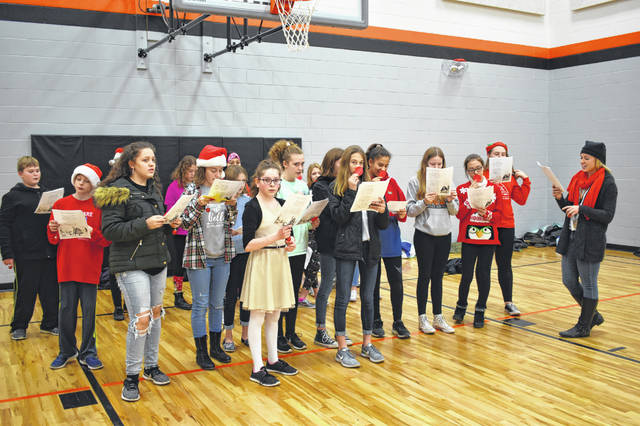 Dempsey Middle School French Club students rehearse with their teacher Megan Helgeson Friday afternoon in the gym at Carlisle Elementary in Delaware. The students gathered together to sing songs for SACC students at Carlisle.