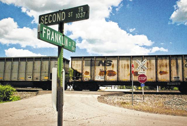 In this Gazette file photo, a train passes by the intersection of Franklin and Second streets in Lewis Center. On Saturday morning, a Columbus man was killed at this railroad crossing when his vehicle was struck by a Norfolk Southern train.