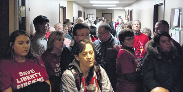 Residents of Liberty Township were asked to move to the hallway if they were not sitting in a one of the provided chairs in the main hall. Speakers who found themselves in the hall had to fight their way through the crowd to the lectern to speak.