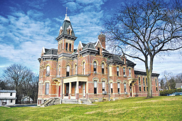 The Delaware County Board of Commissioners rejected the bids for the historic jail and former sheriff's office, pictured, with the intent of transferring the property to the Delaware County Land Reutilization Corporation. According to the National Archives Catalog, the building was placed on the National Register of Historic Places on June 12, 1990. The Queen Anne-style building was constructed in 1878 at a cost of $25,845, and it was designed by architect David W. Gibbs of Toledo.