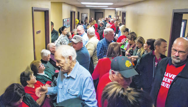 The Liberty Township Board of Trustees scheduled an executive session at the beginning of its meeting Monday night, which caused a large crowd to be moved from the township hall into the hallway of the fire station. The crowd remained there until the executive session ended.