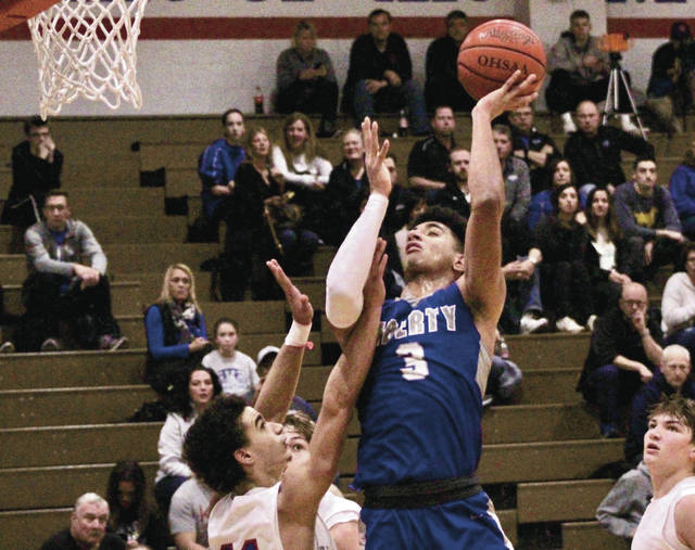 Olentangy Liberty senior Ben Roderick goes up for a shot in the second half of the Patriots' 80-55 non-league win at Marysville Saturday night.