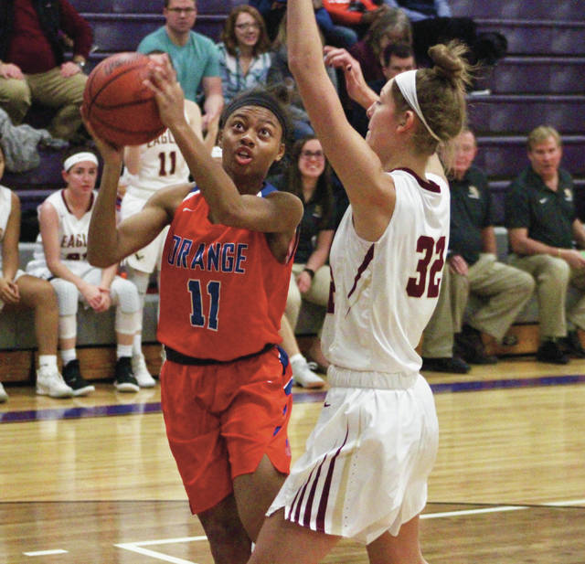 Orange's Camille Barron (11) drives toward the hoop against New Albany's Maddy Hofmann during the first half of a Stallion Holiday Classic showdown Thursday at DeSales.