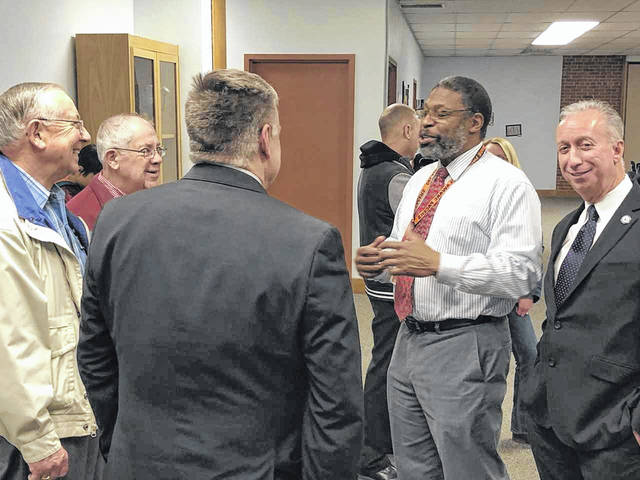 Retiring Director of Technology for Delaware City Schools, Stanley McDonald (in white) chats with former and current school staff at his retirement party on Dec. 19. McDonald began substitute teaching in the district in 1990 and was later put in charge of educating teachers about technology before eventually becoming the district's director of technology.