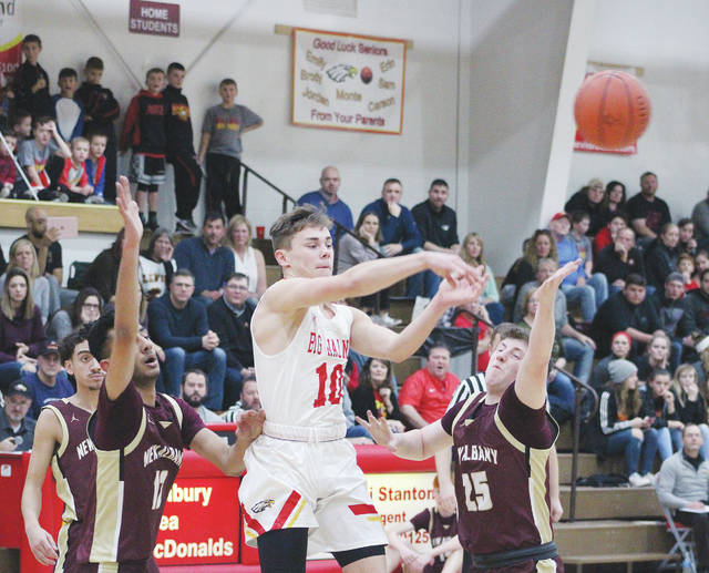 Big Walnut's Nathan Montgomery (10) fires a pass between a pair of New Albany defenders during the first half of Friday's league showdown in Sunbury.