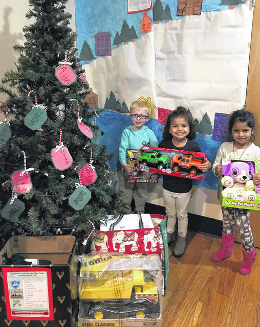 Kindergarten students from Enchanted Care Kids Campus in Delaware recently visited Recreation Unlimited in Ashley to deliver a donation of 240 gifts collected by all Enchanted Care® locations and Ready Set Grow.