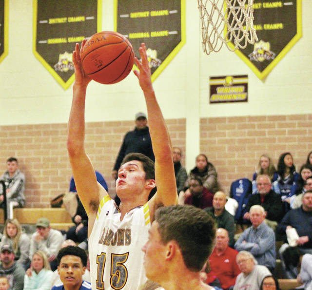 Buckeye Valley junior Max Stokey pulls down a rebound in the first half of the Barons' 41-36 win over visiting Olentangy Berlin in non-league action Saturday night.