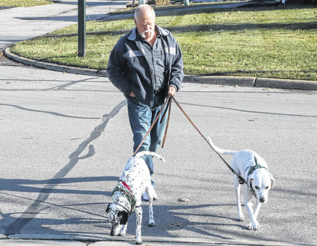 Chuck Stenger walks his two dogs around his neighborhood. Chuck is the first person in the U.S. to receive the Calypso Knee System, an implant designed to relieve knee pain caused by osteoarthritis and prevent or delay the need for a total knee replacement.
