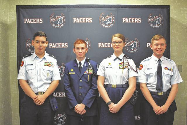Cadets of various grades and ranks pose for a photo Thursday at Hayes High School. From left to right: Patrick Beck, a sophomore at Hayes and second year cadet; A.J. Bell, a junior at Olentangy Orance High School and third-year cadet; Alex Naugle, a senior at Olentangy Orange and fourth-year cadet; and Adam Willis, a sophomore at Hayes and first-year cadet.
