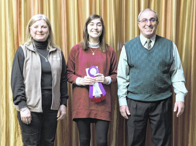 """Olentangy High School student Hailey Piché's ceramic work entitled """"Stigma"""" was named Best of Show in the Delaware County High School Art Show currently on display at The Delaware Arts Castle. Pictured, left to right, are M. Caroline Jones from Fidelity Federal Savings & Loan, Piché, and Arts Castle board member Walt Abood."""