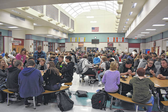 Students eat lunch at Hayes High School on Monday, the first day back from winter break. The last day for students is May 29.