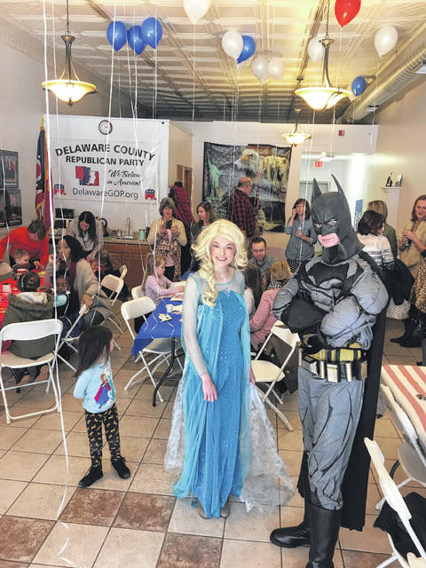 During the GOPMoms kickoff event held Jan. 21 at the Delaware County Republican Headquarters in downtown Delaware, area kids were treated to a surprise visit from Elsa and Batman.