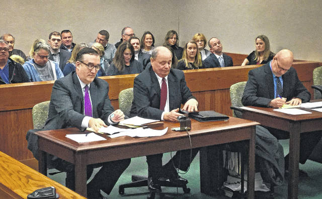 Courtroom B inside the Delaware Municipal Court was packed Monday with Liberty Township residents. Seated in front of the residents, left to right, are the lawyer for Trustee Michael Gemperline, Gemperline, and Gary Yashko, the attorney representing township residents.