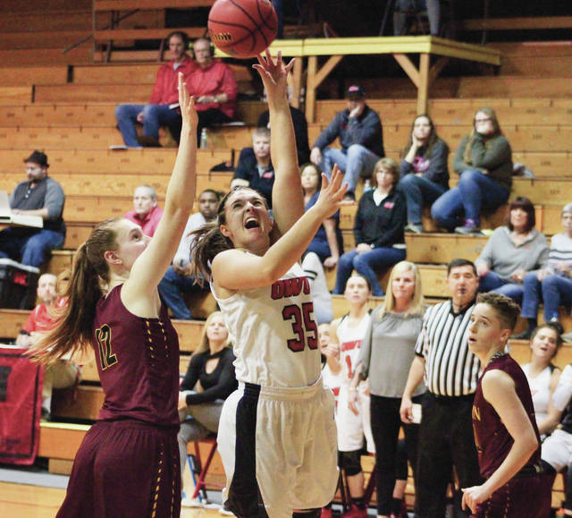 Ohio Wesleyan's Elea Karras (35) puts up a shot over Oberlin's Maggie Gross during the second half of Wednesday's NCAC showdown at Branch Rickey Arena.