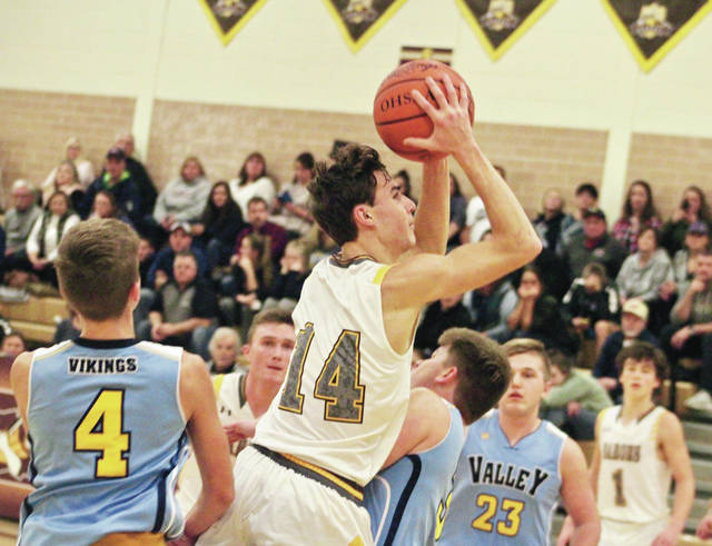 Buckeye Valley's Dylan Herbert (14) soars toward the hoop during the second half of Thursday's MOAC showdown against visiting River Valley.