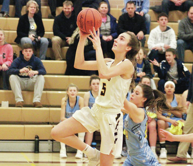 Buckeye Valley's Dani Grether (5) soars in for a hoop during the first half of Thursday's MOAC showdown against visiting River Valley.