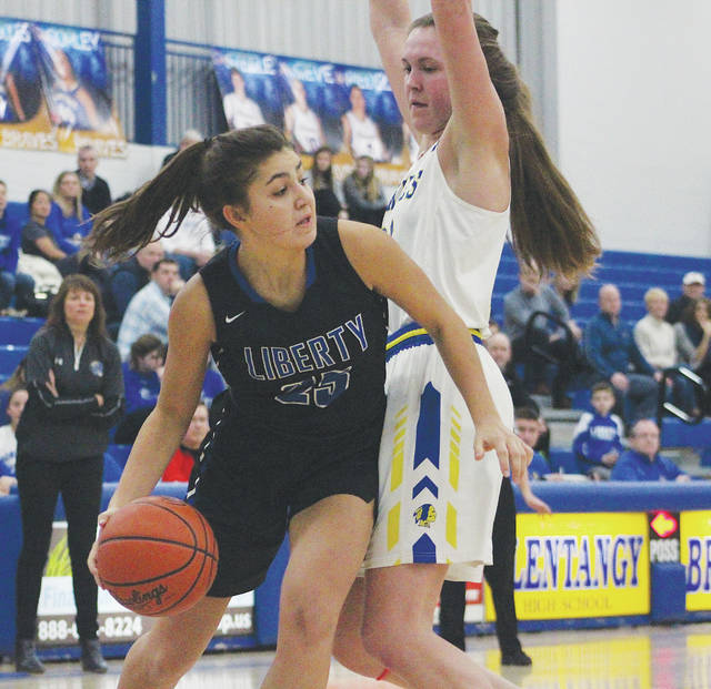 Olentangy Liberty's Kelly Levering, left, looks to get around Olentangy's Olivia Margolies during the first half of Friday's OCC showdown in Lewis Center.