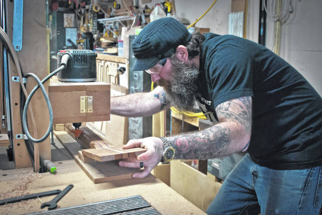 There are no computerized machines to guide the woodworking process in Chase Gullett's guitar-making shop in Ostrander. Everything he creates is guided by his own hand. In fact, Gullett built several of the router tables and jigs he uses to shape the body and necks of his guitars.