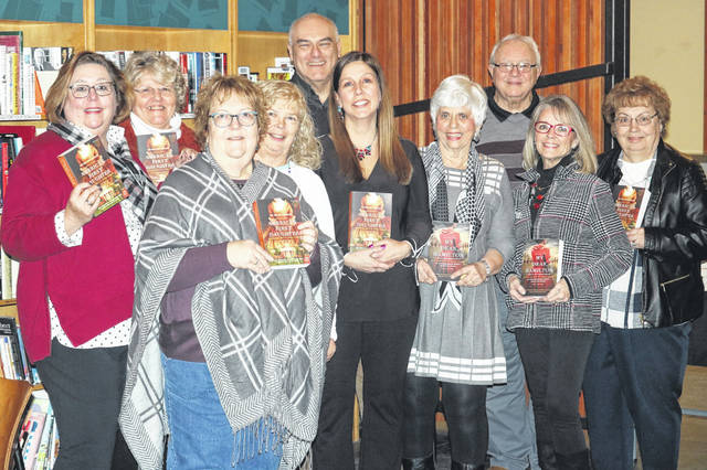 New York Times bestselling author Laura Kamoie recently visited with the Friends of the Delaware County District Library. Kamoie is pictured (wearing all black) in the center of the group.