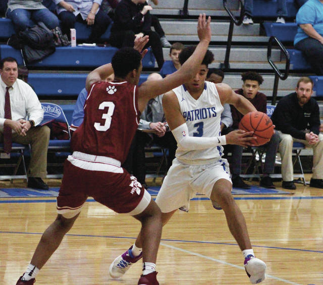 Olentangy Liberty's Ben Roderick, right, makes a move against Newark's Keshawn Heard during the first half of Tuesday's non-league showdown in Powell.
