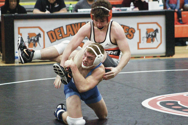 Olentangy Berlin's Corey Hill, bottom, wrestles against Hayes' Emmett Cain during Thursday's dual in Delaware.