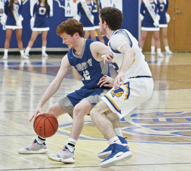 Olentangy Liberty's Joey Thatcher, left, tries to dribble around Olentangy's Sean Marks during the second half of Friday's OCC showdown in Lewis Center.