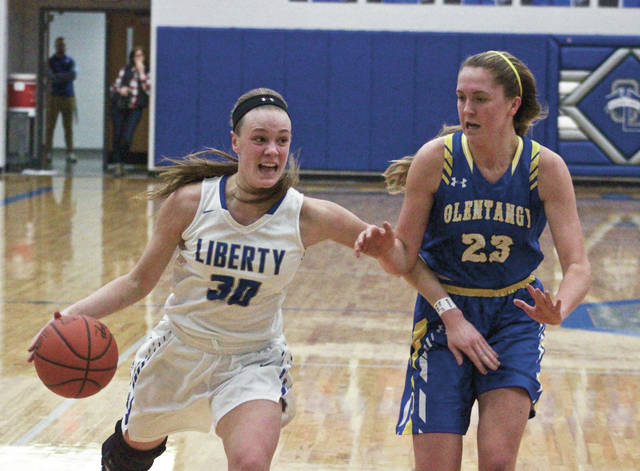 Olentangy Liberty's Teegan Pifher, left, drives past Olentangy's Olivia Margolies during the first half of Saturday's Division I district tournament opener in Powell.