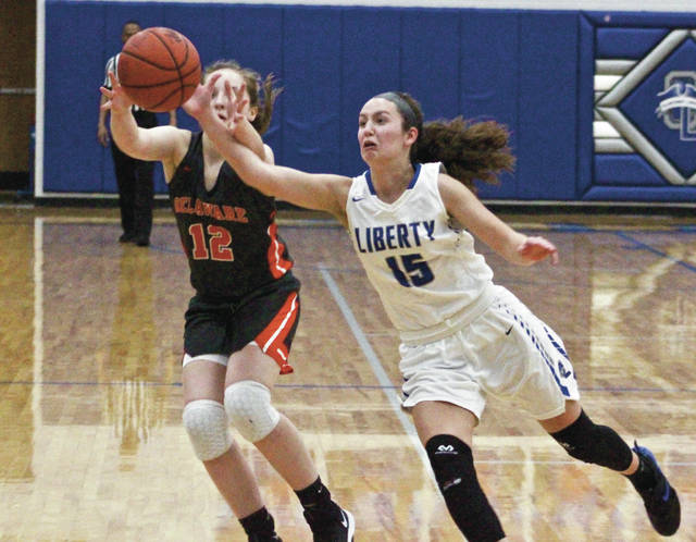 Olentangy Liberty's Jessie Barna (15) steps in front of a pass intended for Delaware Hayes' Chloe Jeffers (12) during the first half of Friday's Division I district tournament game in Powell.