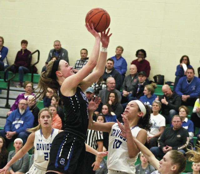 Olentangy Liberty's Teegan Pifher puts up a shot over Hilliard Davidson's Jadah Dixon (10) during the first half of Wednesday's Division I district semifinal in Dublin.
