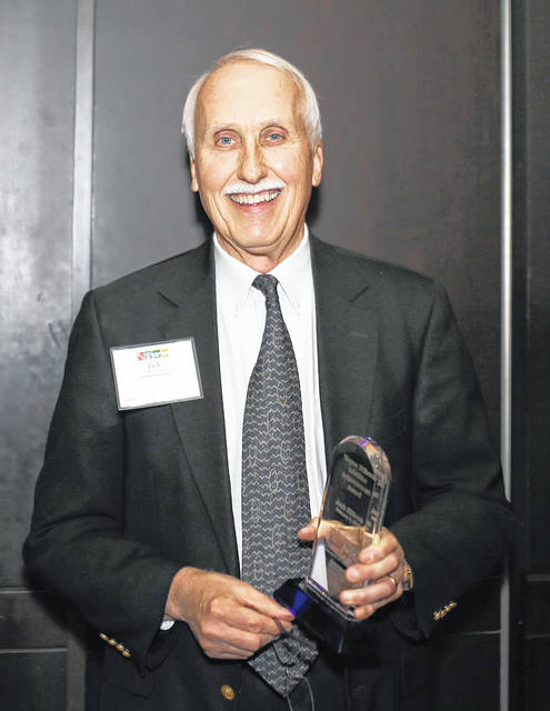Jack Hilborn poses with the Wayne Hilborn Lifetime Achievement Award, which he received from the Delaware Area Chamber of Commerce on Monday. The award is named after his late father, Wayne Hilborn.