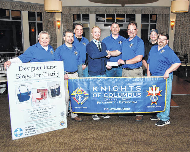 ASFP Ohio Director Bill Hesse accepts the $4,000 donation check from Shane Bendele, Knights of Columbus committee chairman. Pictured, left to right, are David Ayscue III, Dean Moshier, Andy Cross, Bill Hesse, Chris Hicks, Shane Bendele, Steve Garner and Jim Meyer.