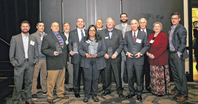 Several businesses were honored on Monday by the Delaware Area Chamber of Commerce. Pictured, left to right, Small Business of the Year — Meade and Associates: Sean Meade, Tony Martini, Rod Meade and Patrick Werther; Citizen of the Year: Joe Pemberton, Suburban Natural Gas; Quality of Life Award — The Strand Theatre: Tracy Peyton; (back) Brian Meade; Corporate Citizen of the Year — Middlefield Bank: Chuck Moore; (back) Innovation in Business — Aler Stallings: Brenon Russell; Wayne Hilborn Lifetime Achievement Award: Jack Hilborn; and Large Business of the Year — Custom Air: Pat Halaiko; Aler Stallings Amy Himmelrick and Broc Sutek. Not pictured: Outstanding Chamber Member of the Year — Willow Brook Christian Communities.