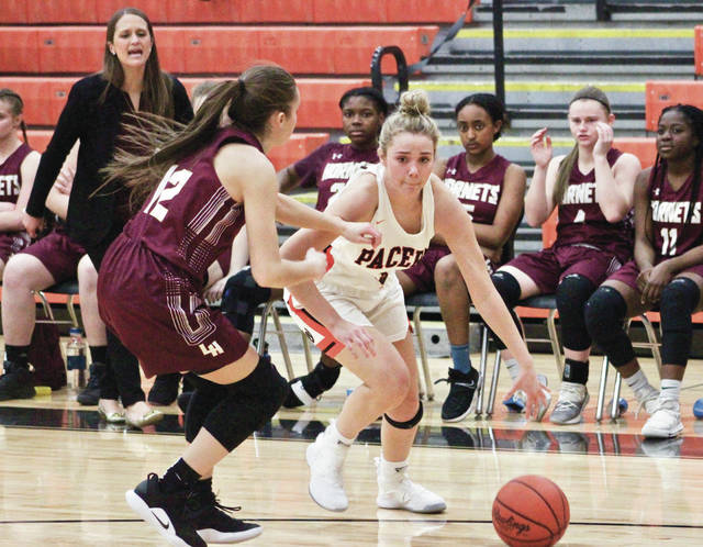 Hayes' Piper Adkins drives against Licking Heights' Kaitlin Thompson (12) during the first half of Wednesday's non-league showdown in Delaware.