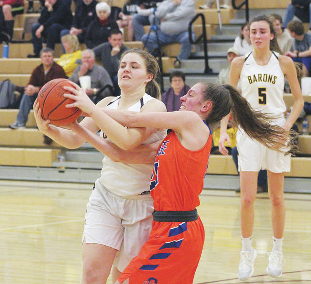 Buckeye Valley's Cami Crawford, left, and Olentangy Orange's Riley Duffy battle for possession during the first half of Tuesday's non-league showdown in Delaware.