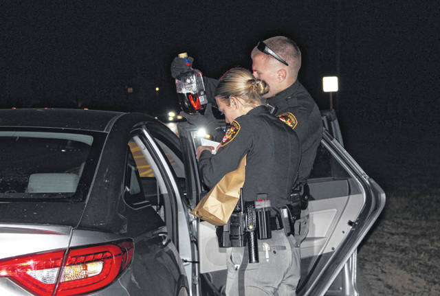 Delaware County Sheriff deputies Rachel Wooten and Josh Bender investigate a drunk driver call in 2018.