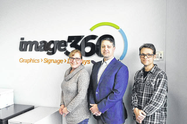 Pictured, left to right, are Image360 owners Ronni and Bryan Kinglsey, along with their designer, Dominic Sanzone.