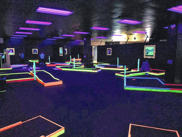 Pictured is a portion of the 18-hole blacklight mini golf course located inside Mystic Golf and Games at 1159 Columbus Pike in Delaware. The location is the former home of both Damon's Grill and Aaron's.