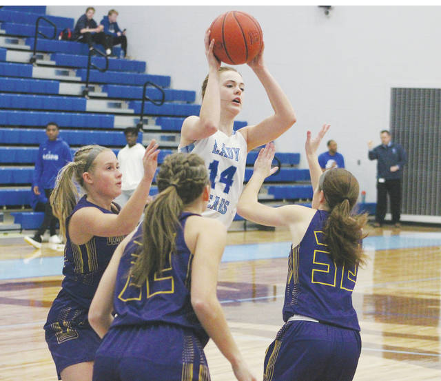 Olentangy Berlin's Jessica Nation (14) passes out of a crowd of Bloom-Carroll defenders during the first half of Tuesday's Division II district tournament game in Delaware.