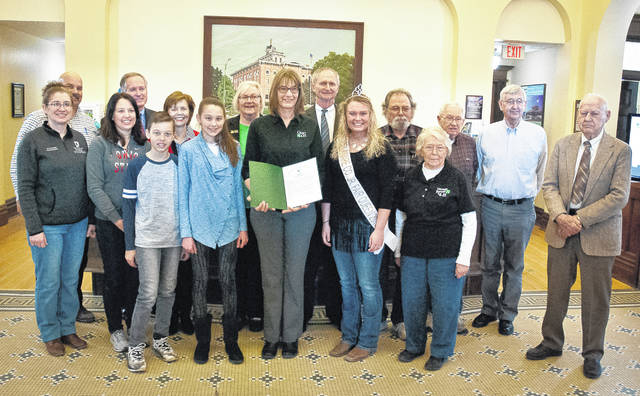 Delaware County 4-H is celebrating 100 years of service and connecting youth to hands-on experiences that teach kids how to succeed in life. The Delaware County Board of Commissioners honored the 4-H clubs with a proclamation during its Thursday session. Pictured, left to right, back row: Jon Melvin, Commissioner Jeff Benton, Commissioner Barb Lewis, Cheryl Hagerty, Commissioner Gary Merrell, Harold Wolford, Walter Morton, Ralph Jordan and Bob Irvin; front row: Kathy Blevins, Julie Riley, Michael Riley, Allison Riley, Laryssa Hook, Lauren Van Gundy and Donna Morton.