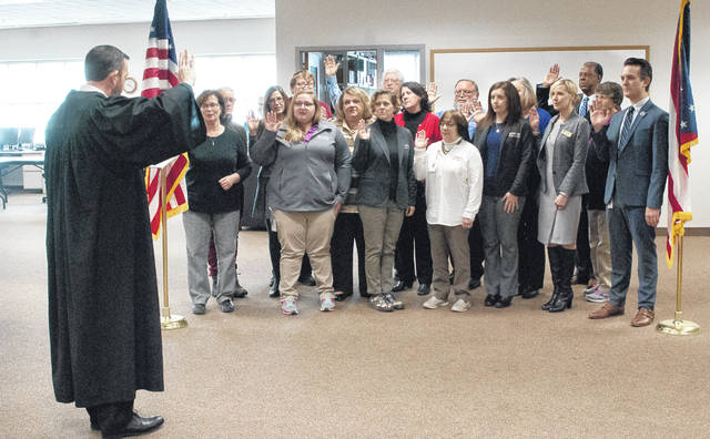 During Delaware County Board of Elections' annual reorganizational meeting on Tuesday, full-time staff was rehired for the year and sworn in by Delaware County Common Pleas Court Judge James Schuck, left.