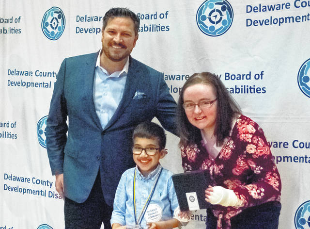 "The Delaware County Board of Developmental Disabilities (DCBDD) honored nine recipients during its annual ""Lifetime of Giving"" event Thursday evening. Pictured, left to right, are Louis Borowicz, DCBDD president; 9-year-old Ashdin Hoffman, 2019 recipient of the Outstanding Advocate Award; and Rachel Barber, 2018 recipient of the Outstanding Advocate Award."